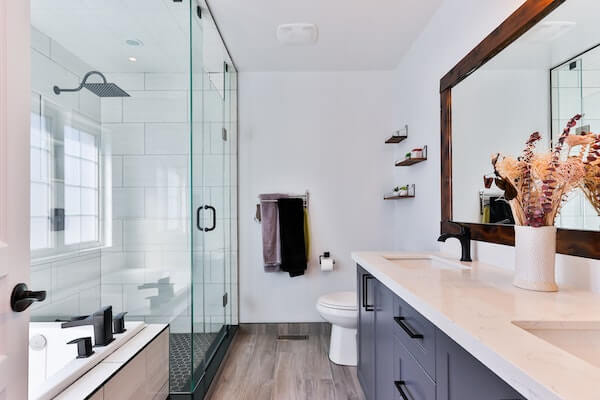 white ceramic sink and glass shower door in a residential bathroom